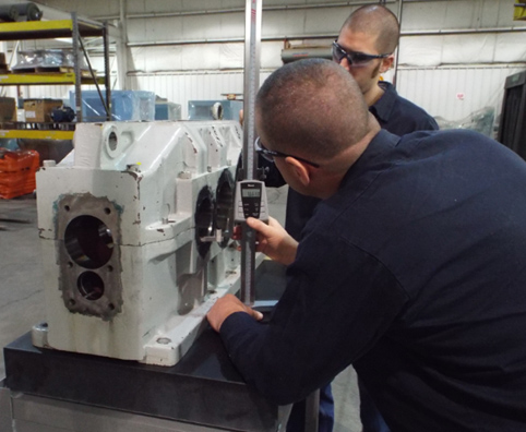 Gearbox Technicians Measuring Concentricity of Housing Bores
