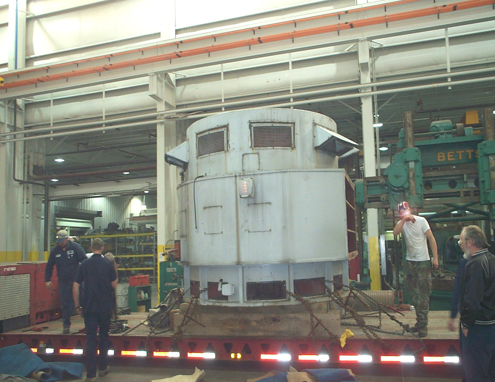 Smith Services' workforce removes a vertical pump motor from incoming trailer.